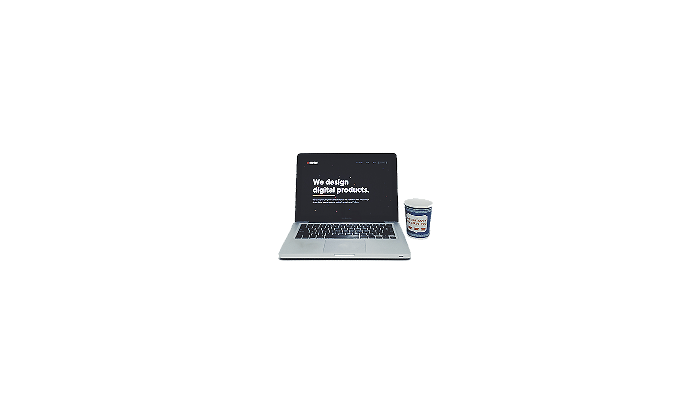 A laptop and coffee cup