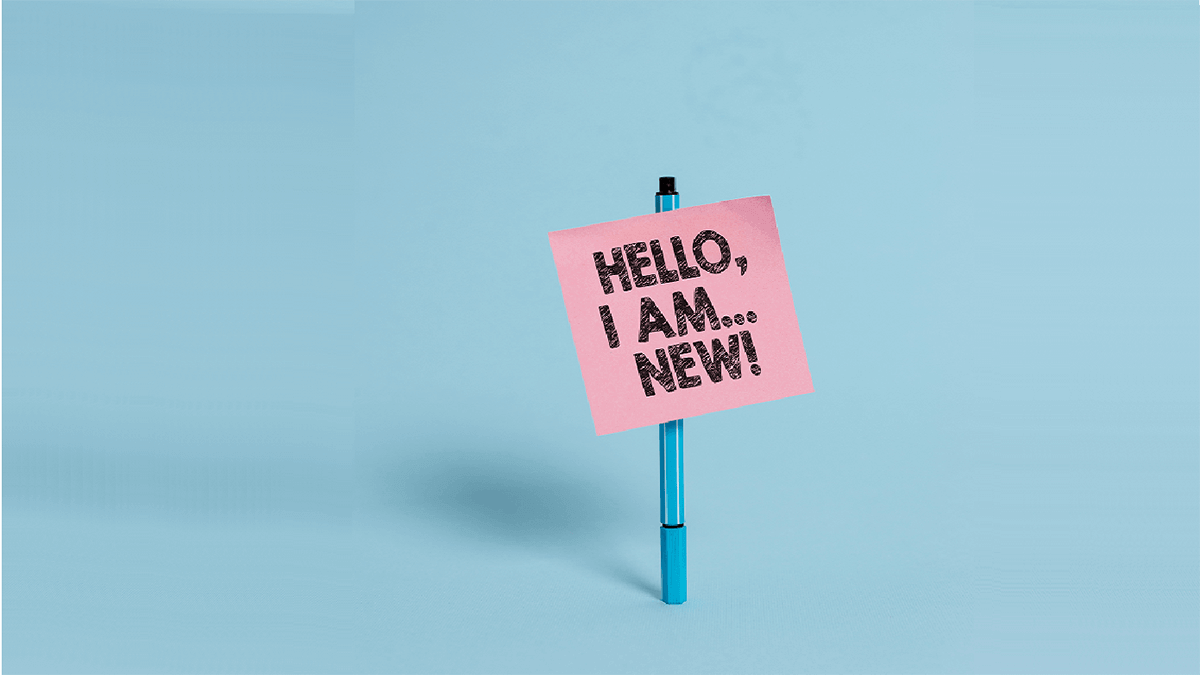 "Pink sign that reads ""Hello, I am new!"""