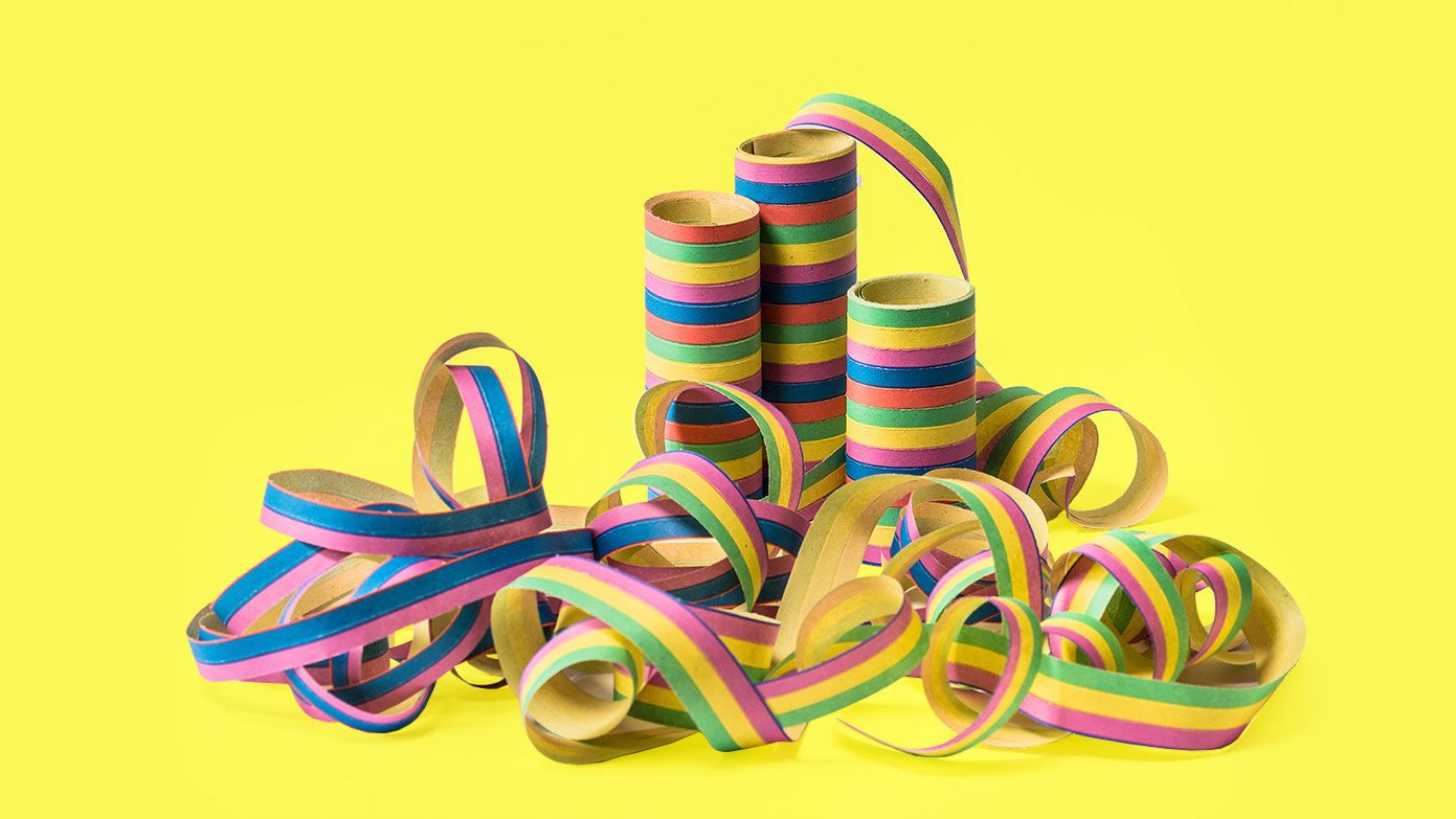 Multi-coloured party string on a yellow background